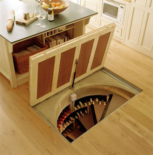 Trapdoor in the kitchen floor spiral wine cellars rool for Wine cellar in floor